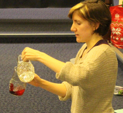 Katie pouring a jug of water into wine!